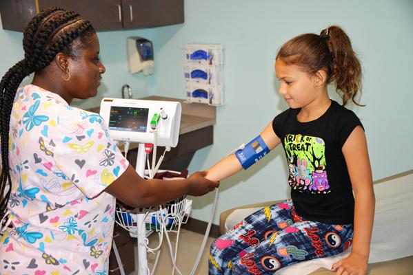 Nurse taking a child's vitals