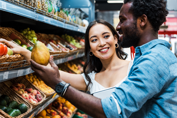 Man and woman selecting nutritious food at the grocery store
