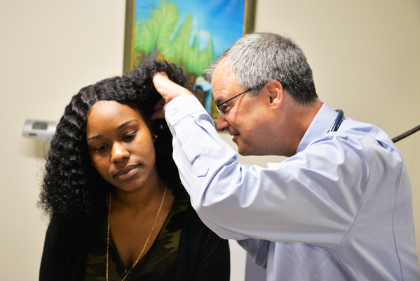 Dr. Pincus checking a patient's ear