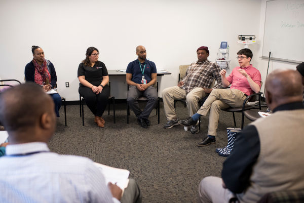 Adults seated in a circle in a group care session