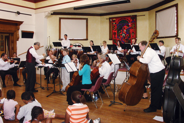 Orchestra playing at music event in the Great Hall