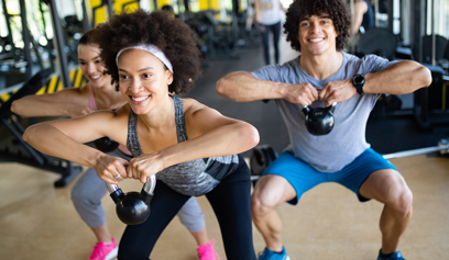 Three people working out in a gym