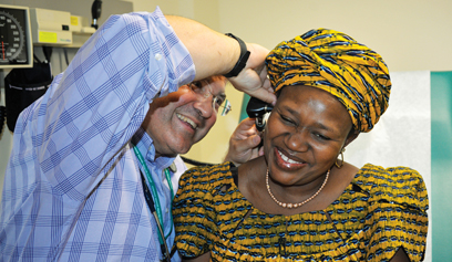 Dr. Naimi examining a patient's ears