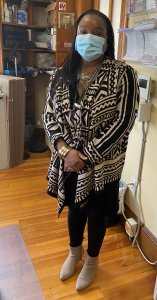 Executive Assistant Lisa Hamblin wears cultural jacket